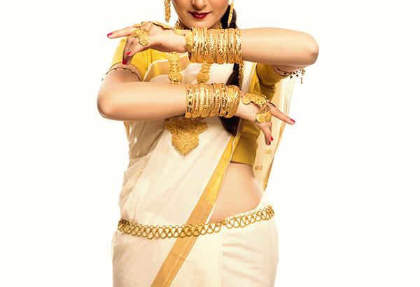 Woman adorning traditional gold waist-belt