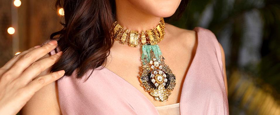 woman wearing gold jewellery